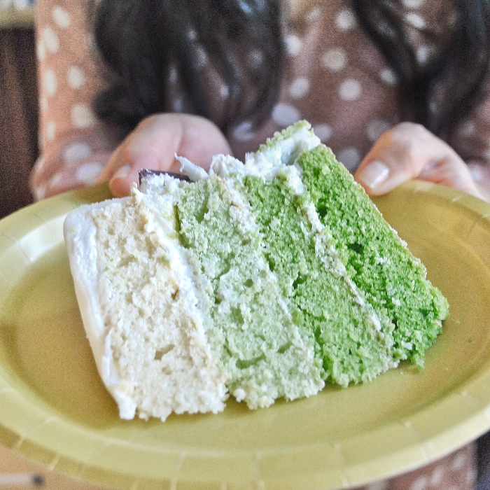 Four layers of vanilla cake with a gradient green ombre
