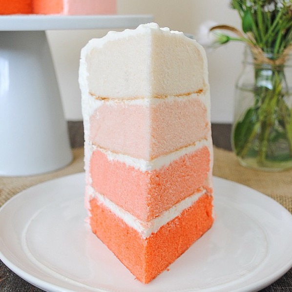 Four layers of vanilla cake with a pink ombre