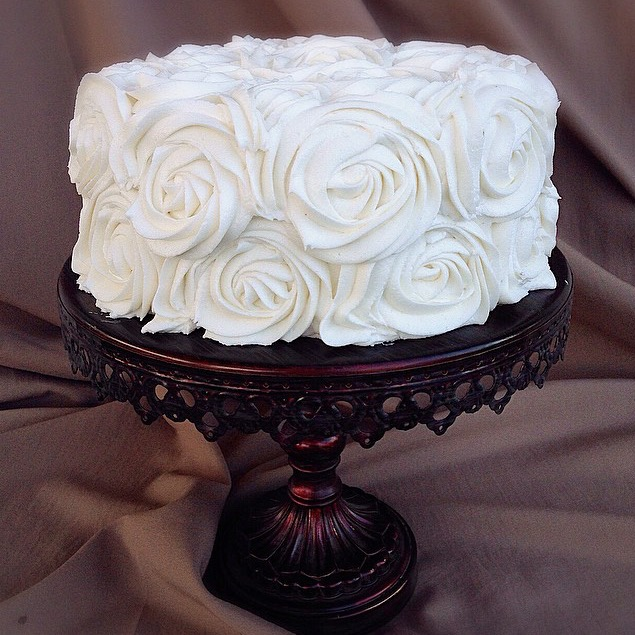 Cake decorated with large buttercream rosettes