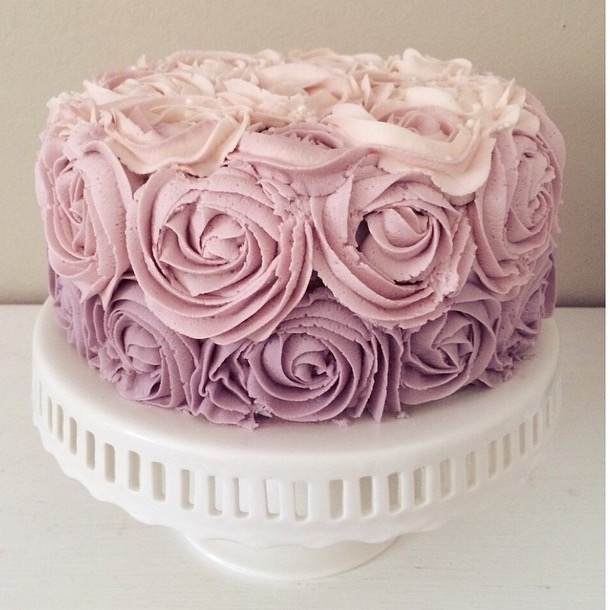 Cake decorated with large ombre buttercream rosettes