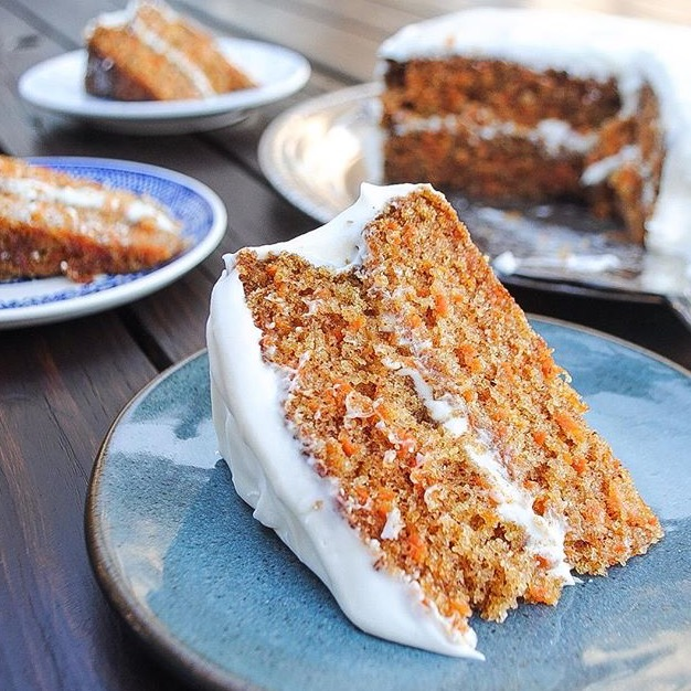 Classic carrot cake is frosted with cream cheese frosting